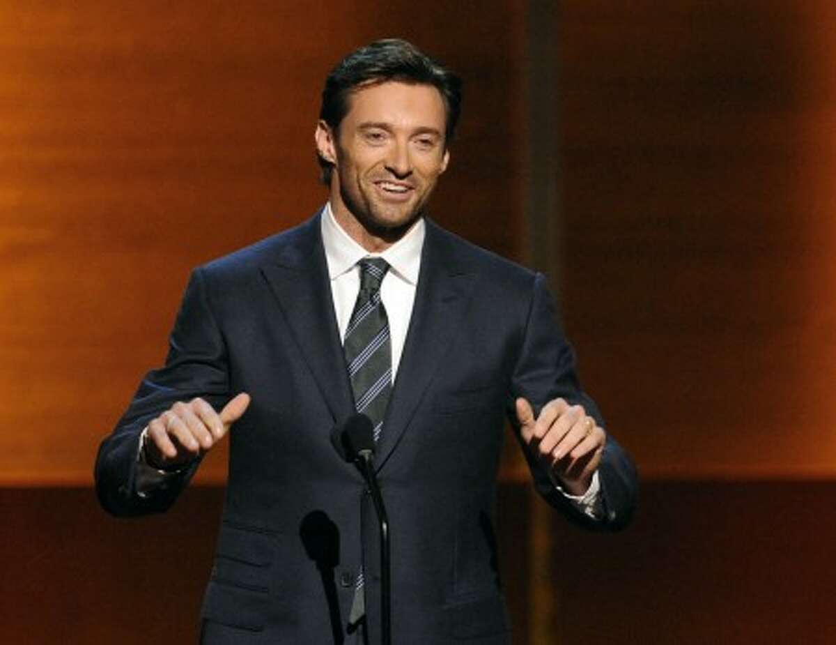 Actor Hugh Jackman presents during the CNN Heroes: An All Star Tribute awards show, Saturday, Nov. 22, 2008, in the Hollywood area of Los Angeles. (AP Photo/Gus Ruelas)