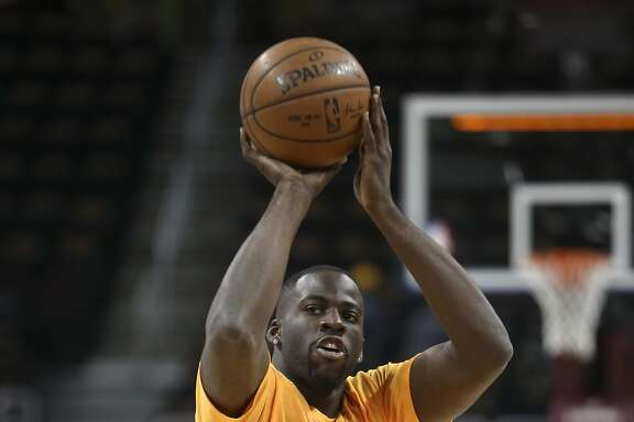 Golden State Warriors' Draymond Green shoots during warmups before Game 6 of basketball's NBA Finals against the Cleveland Cavaliers in Cleveland, Thursday, June 16, 2016. (AP Photo/Ron Schwane)