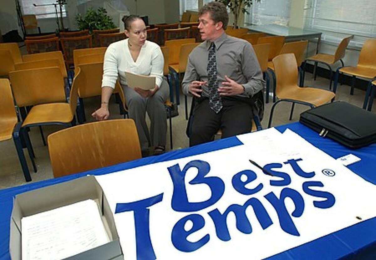 Recruiting Manager for Best Temps, Dave Steel, right, chats with Siobhan Lopez during NEON''s Norwalk Works Job Fair Friday at the former Ben Franklin School. Hour photo / Erik Trautmann