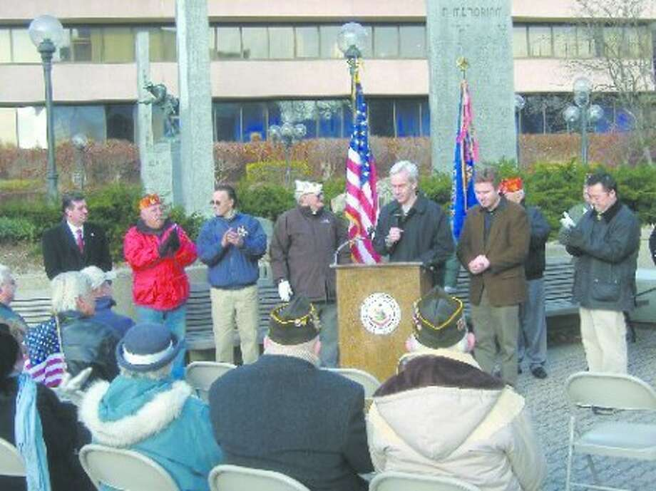 Local legislators, officials and residents gather for a Pearl Harbor Day remembrance ceremony in Veterans Park.