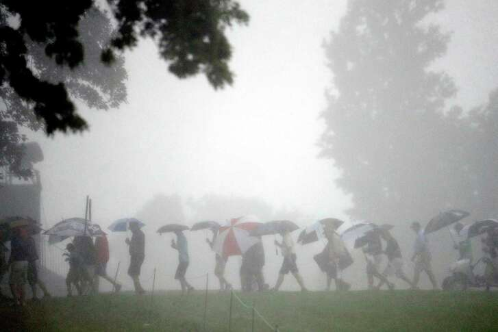 Umbrellas became the accessory of choice for U.S. Open fans as rain caused three suspensions of the first round Thursday, with the final one ending play for the day in midafternoon. Only nine players finished their rounds and 78 did not begin play.