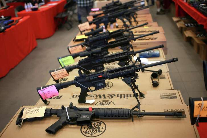 Smith & Wesson AR-15 rifles for sale at a gun show in Loveland, Colo., Oct. 11, 2014. The military-style gun, a version of which was used in the Pulse night club mass shooting that left 50 dead on June 12, 2016, has become, simultaneously, one of most beloved and most vilified rifles in the country. (Luke Sharrett/The New York Times)