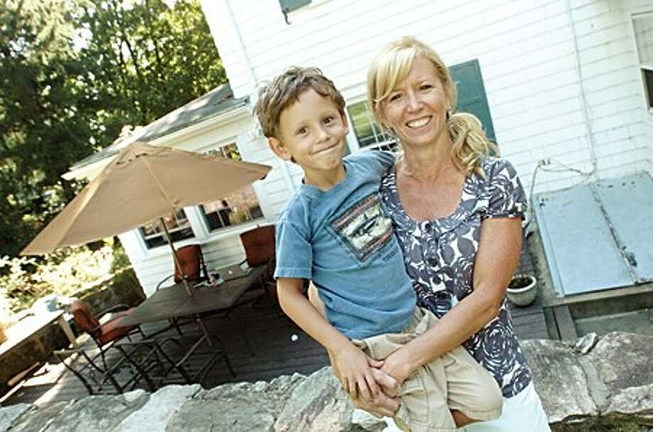 Jacqui Moody and her son Jackson at her Norwalk home on Friday. Jaqui is the head writer for the children''s program Wordworld which won two Emmys/hour photo matthew vinci
