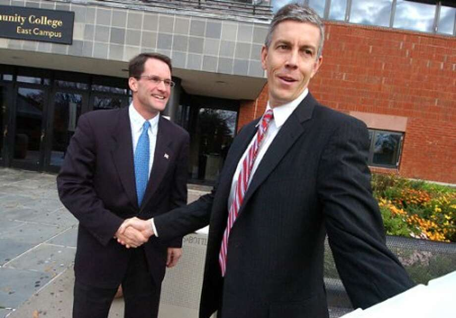 Photo/Alex von Kleydorff. Congressman Jim Himes and Secretary of Education Arne Duncan meet and talk just before a forum at Norwalk Community College on Monday