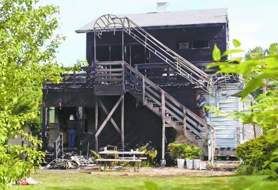 The back of the home on Burwell St. in Norwalk that was destroyed by a fire which killed 2 people early Tuesday morning. Hour photo / Erik Trautmann
