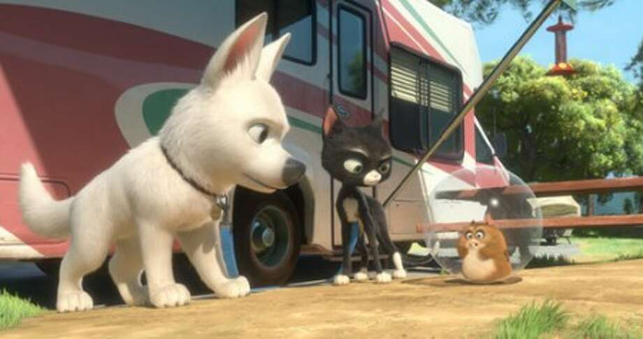 "From left, Bolt, Mittens and Rhino are shown in a scene from the film, ""Bolt."" (AP Photo/Disney)"