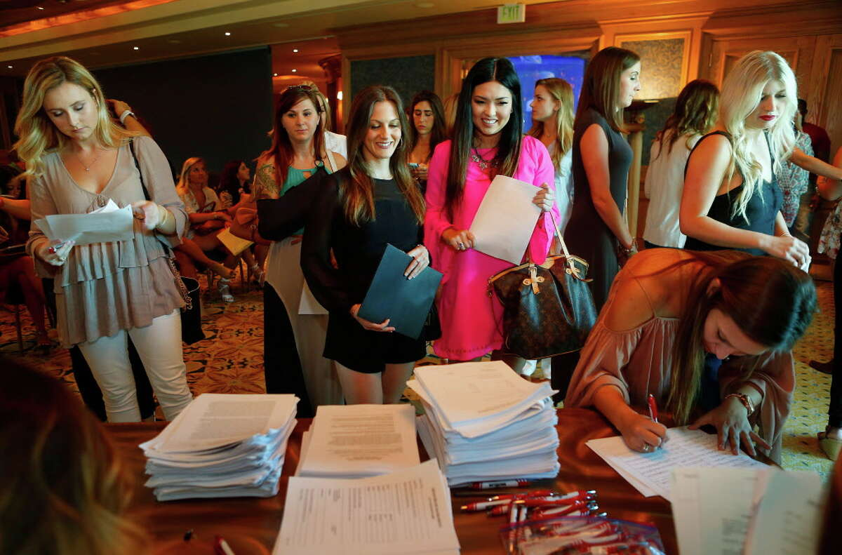 Hopeful contestants for the Bachelor series show up for auditions at the Downtown Aquarium in Houston, Thursday, June 16, 2016.