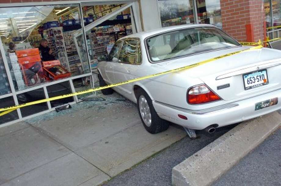 A car was driven through the window of the Bed Bath and Beyond on Westport Avenue around 2 PM in Norwalk Thursday afternoon. Hour Photo / DANIELLE ROBINSON