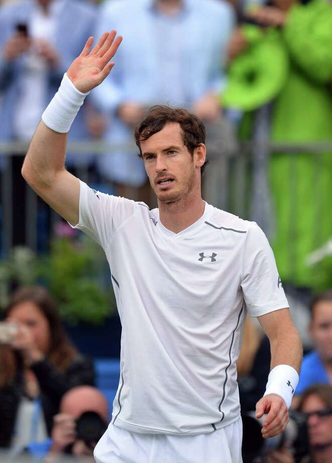Britain's Andy Murray waves to fans after beating Britain's Aljaz Bedene in their second round match at the ATP Aegon Championships tennis tournament at the Queen's Club in west London on June 16, 2016. / AFP PHOTO / GLYN KIRKGLYN KIRK/AFP/Getty Images Photo: GLYN KIRK / AFP or licensors