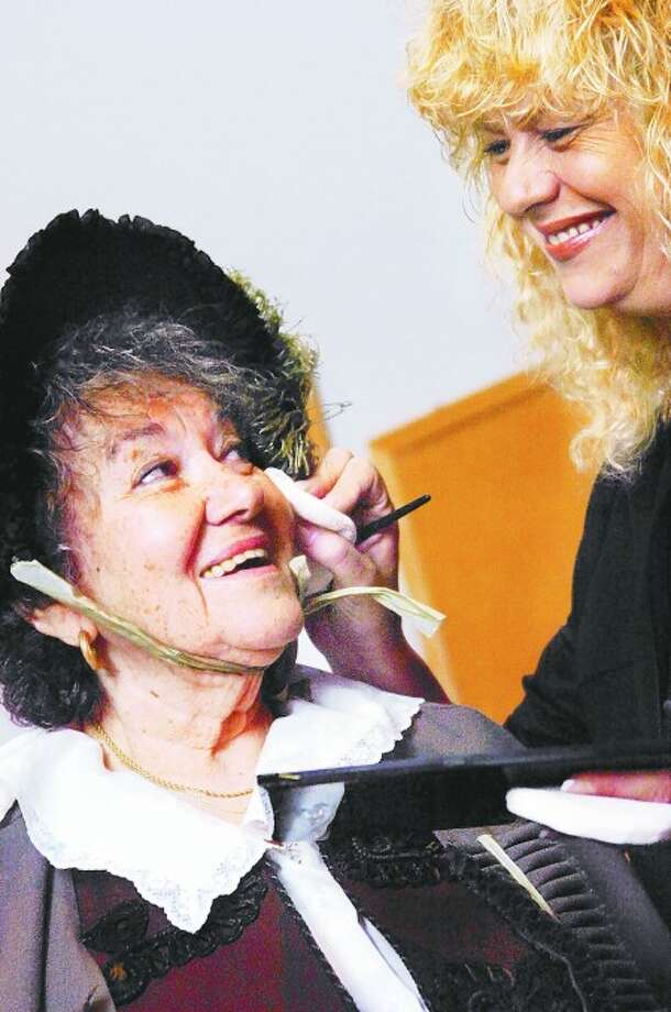 Make-up artist and stylist, Kathleen Richards from Norwalk puts the finishing touches on extra, Genevieve Weingrad at the Palace Studios in Norwalk as the filming began for the Young American Heroes production about Frederick Douglass last week. Hour photo/Matthew Vinci