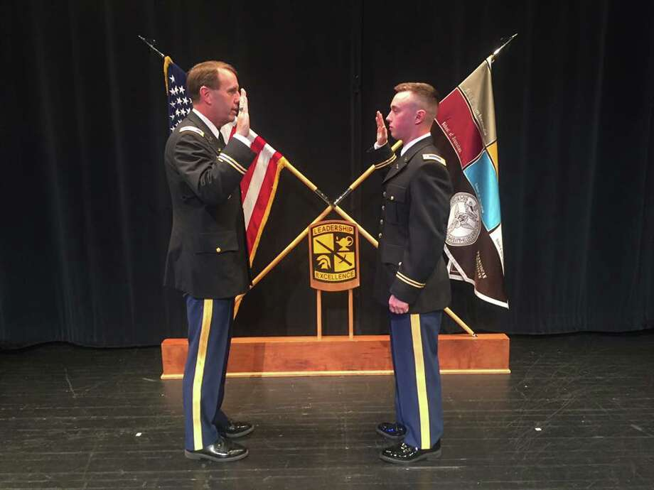 Courtesey of Machina Family Retired New York Army National Guard Col. Gary Machina leads his son, Brian Machina in the Army?s Oath of Commissioning as a second lieutenant during a ceremony at St. Bonaventure University.