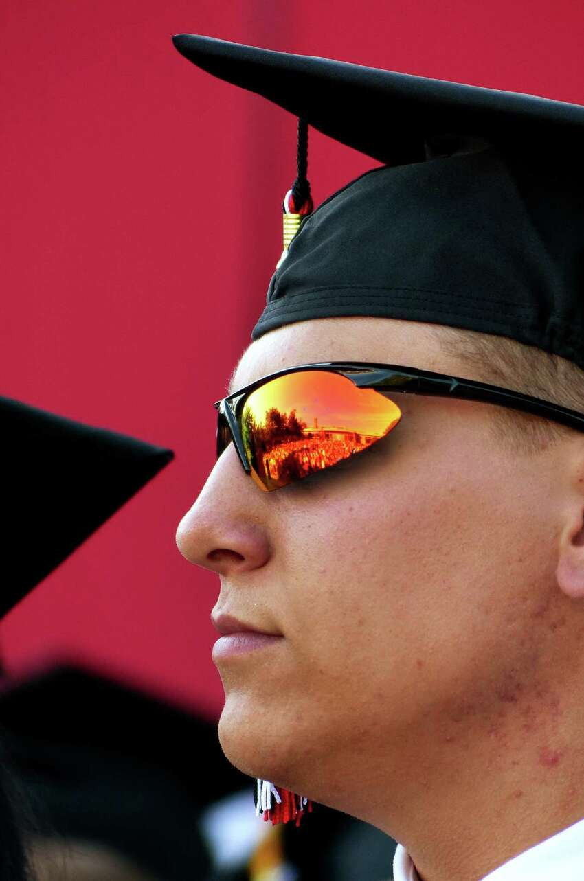 Graduate Benjamin Faria sports a cool pair of sunglasses during Fairfield Warde High School's Class of 2016 Commencement Exercises in Fairfield, Conn., on Thursday June 16, 2016.