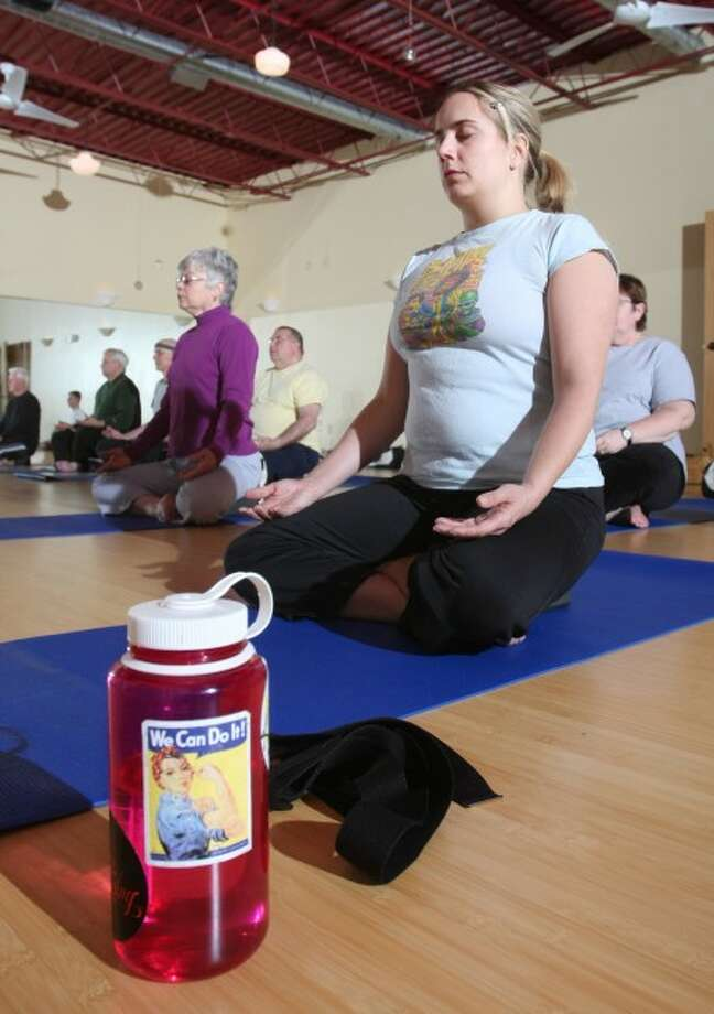 Alicia Jones participates in her first yoga Class at the Darling Yoga Studio. MCT photo