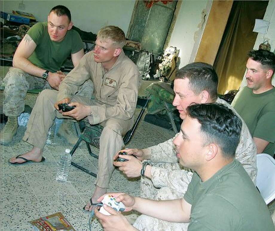 Lance Cpl. Tristan Van Scoy, left, watches as Cpl. Matthew Mooi, Cpl. Brett Maddix, Lance Cpl. Justin Humpich and Cpl. Fernando Izaguirre, all members of Fox Company