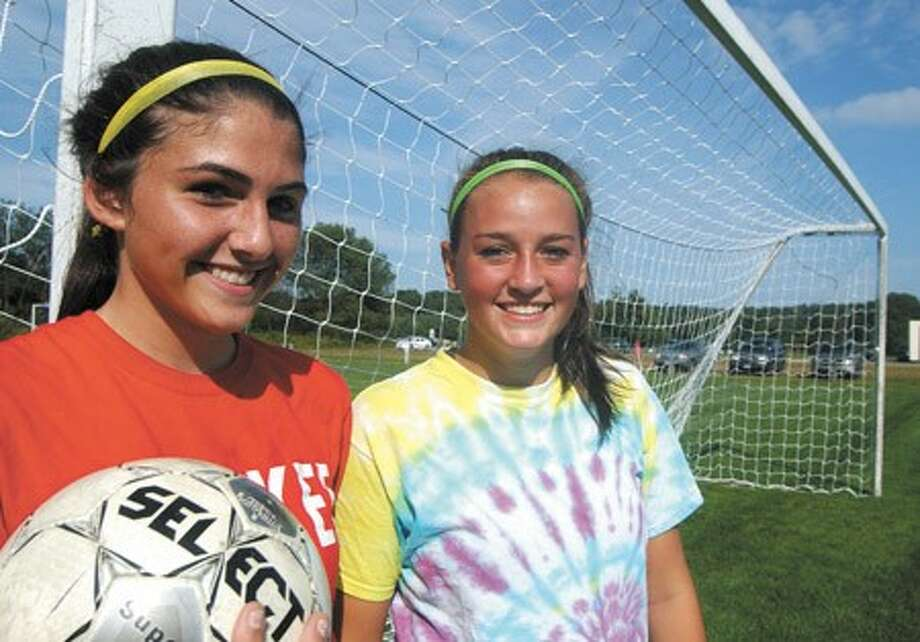 Photo by John Nash - Wilton sophomore soccer goalies Kasey O''Brien and Elizabeth Reda