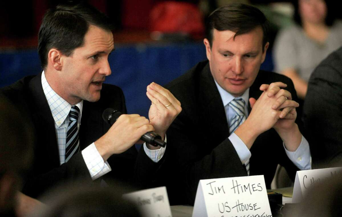 U.S. Rep. Jim Himes (D-Conn.), left, speaks as he sits next to U.S. Sen. Chris Murphy (D-Conn.), right, during a roundtable discussion about curbing gun violence at the Yerwood Community Center in Stamford on Thursday, January 17, 2013.