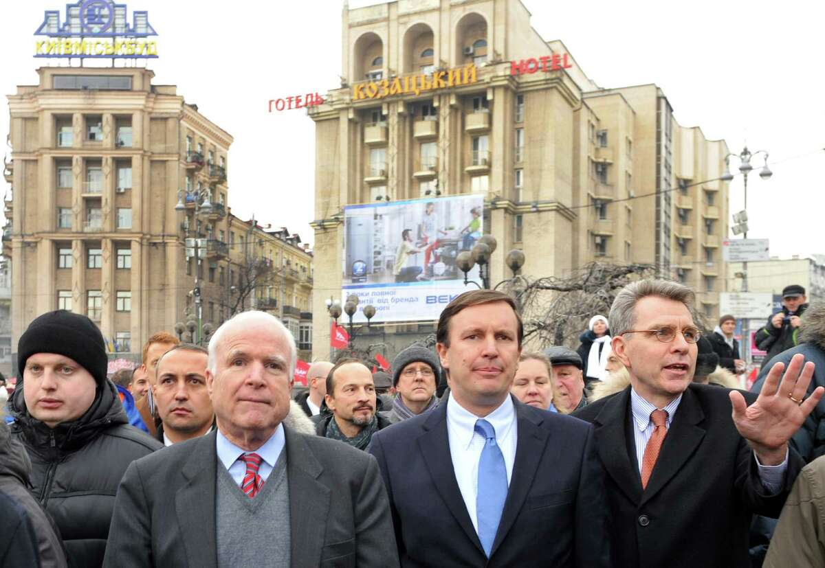 US Senator John McCain (3rd L), US Senator Chris Murphy (Center R) and US ambassador in Ukraine Geoffrey R. Pyatt (R) walk to Independence Square in Kiev during a mass opposition rally on December 15, 2013.