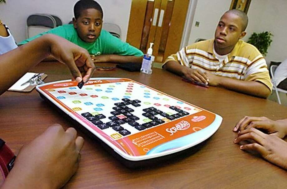 Andre St. Surin 13 and Raquan Calhoun 14, playing for Carver at the first annual Alonso Virgil scrabble tournament the teams were Choices vs. Carver at Grace Baptist Church on Monday/hour photo matthew vinci