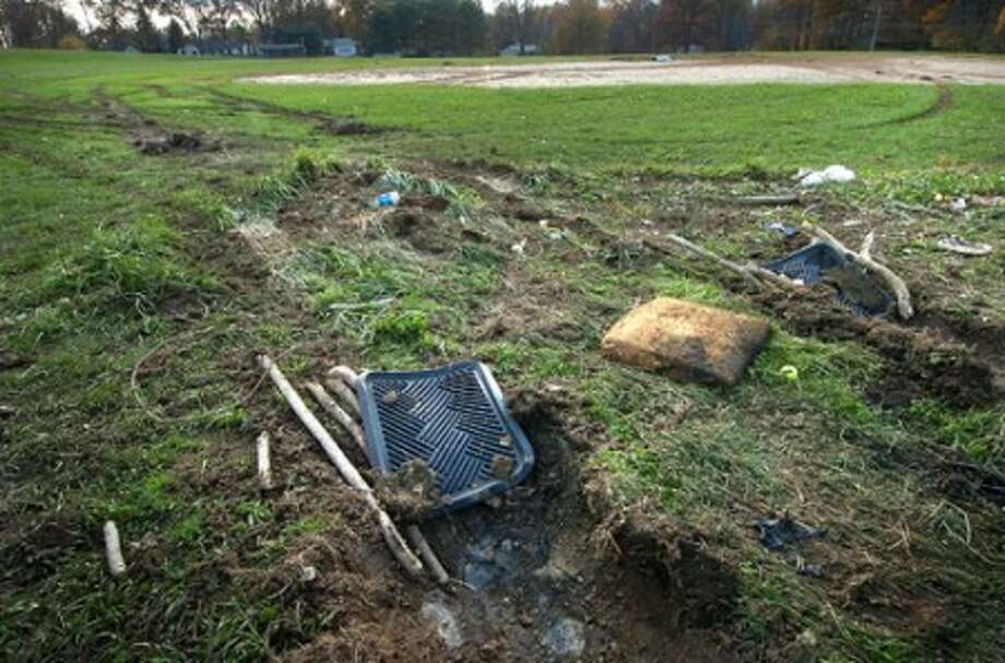 Photo/Alex von Kleydorff. Vandals seem to have used the floor mats from their vehicle, placed under the tires to get traction and un stuck from the playing field at Ponus Ridge Middle school.