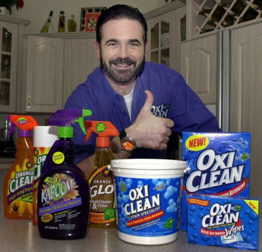 FILE - In this Dec. 6, 2002 file photo,TV pitchman Billy Mays poses with some of his cleaning products at his Palm Harbor, Fla., home. Tampa police say Mays, the television pitchman known for his boisterous hawking of products such as Orange Glo and OxiClean, has died. He was 50. (AP Photo/Chris O''Meara, File)
