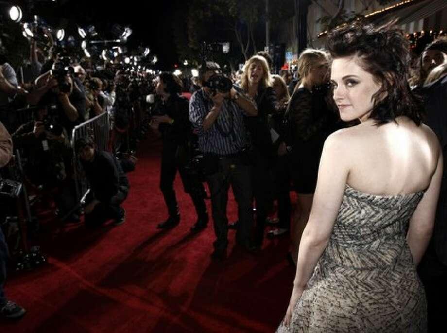 Actress Kristen Stewart arrives at The Twilight Saga: New Moon premiere in Westwood, Calif. Monday, Nov. 16, 2009. (AP Photo/Matt Sayles)