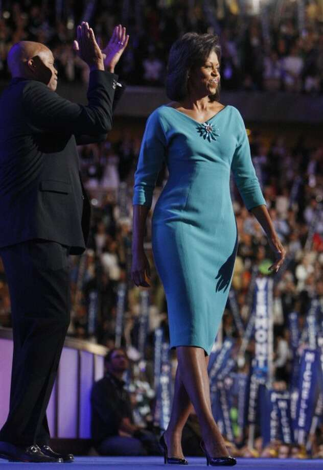 Michelle Obama, wife of President-elect Barack Obama, arrives on stage before her address to the Democratic National Convention in Denver. (AP Photo/Chris Carlson, File)