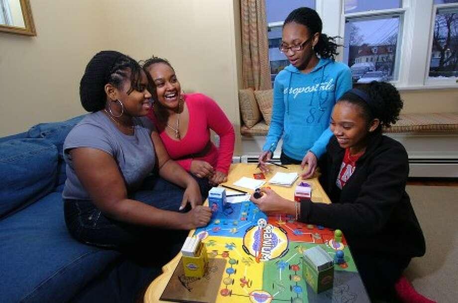 Photo/Alex von Kleydorff. A Better Chance kids play a game of Cranium , l-r Onessa Faulknor, Geena Pabarue, Amanda Allison. and Demaris Mozie.