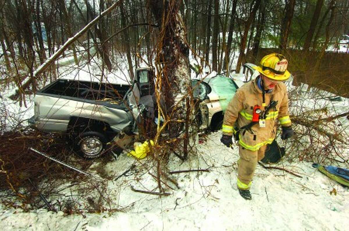 Photo/Alex von Kleydorff. Wilton Fire, Police, ambulance and emergency personnel respond to a one car accident along Rt 33 Westport rd. in Wilton, where a Dodge Pick up truck left the road. Wilton Fire responders used the Jaws of Life to extricate the occupants.
