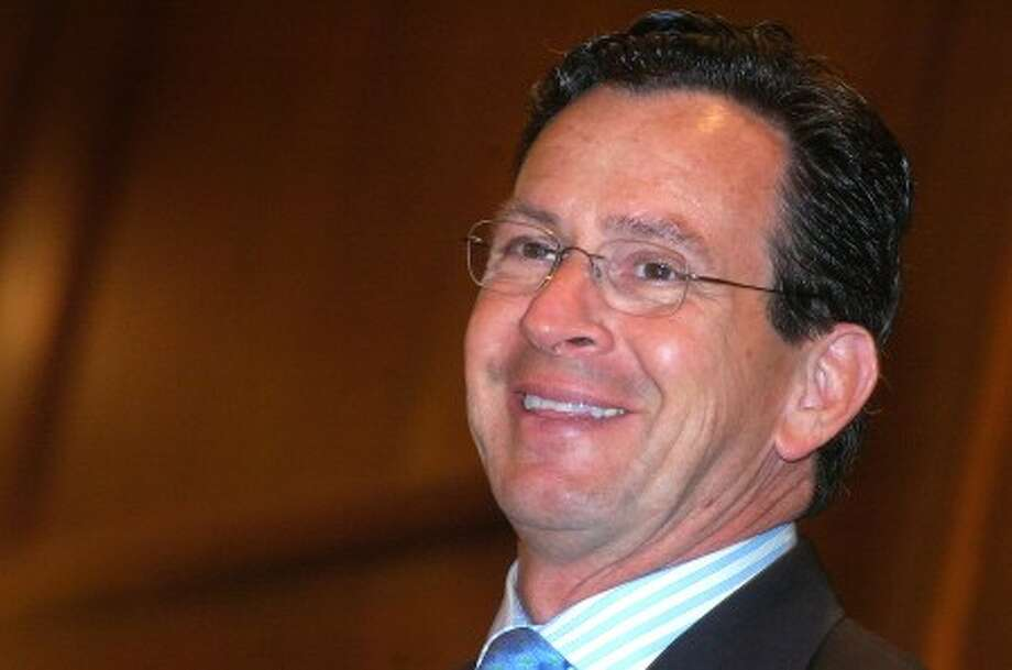 Photo/Alex von Kleydorff. Stamford Mayor Dan Malloy smiles as he speaks for the 14th and final time at the Stamford Chamber of Commerce State of the City Address on Wednesday