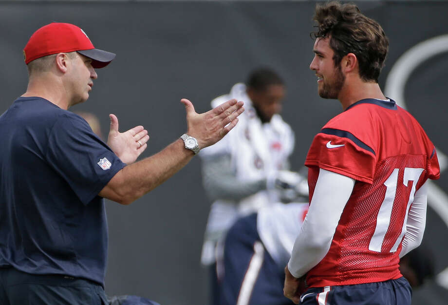 Texans coach Bill O'Brien, left, talks strategy with quarterback Brock Osweiler during offseason workouts at NRG Park on June 10. In Osweiler, O'Brien gains a quarterback who has had a long list of influences on his football development. Photo: Melissa Phillip, Staff / © 2016 Houston Chronicle