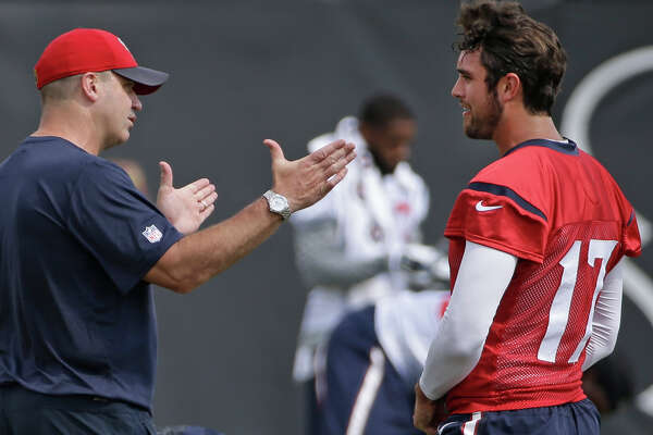 Texans coach Bill O'Brien, left, talks strategy with quarterback Brock Osweiler during offseason workouts at NRG Park on June 10. In Osweiler, O'Brien gains a quarterback who has had a long list of influences on his football development.