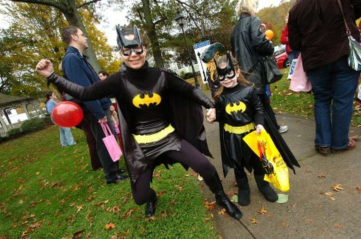 Photo/Alex von Kleydorff. Ariana Royer and daughter 5 3/4 yr old Morgane as super heroes Bat Woman at the Chamber Halloween parade.