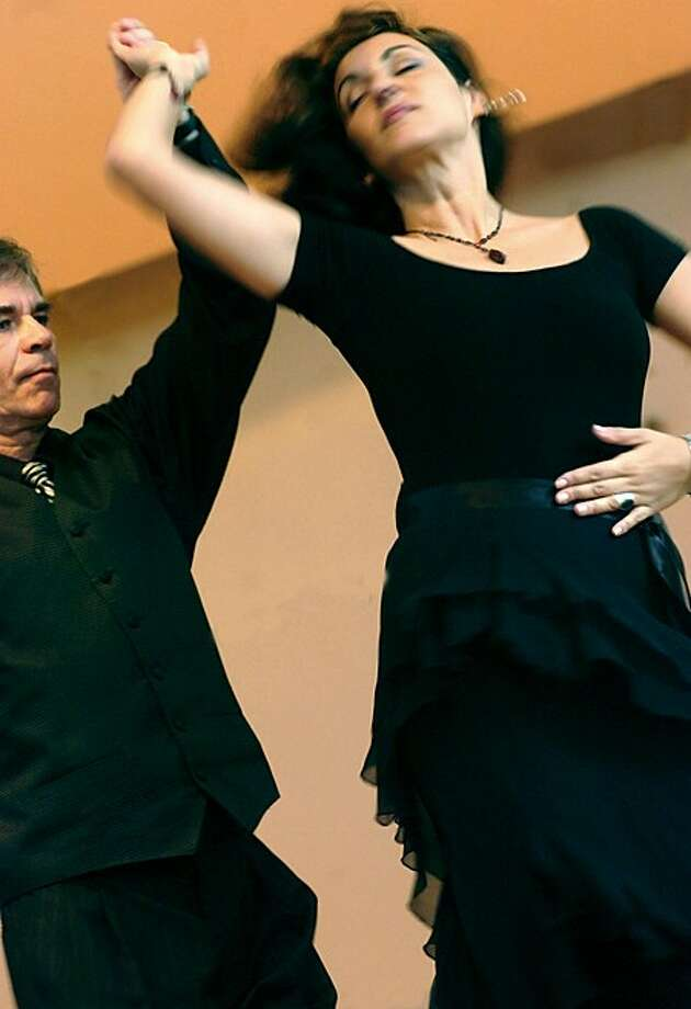 Maria Fiores and Jerry Chy Ikowski dance to the music of Spain, Latin America and South America as the Norwalk Symphony Orchestra performed for Norwalk public school children at the City Hall concert hall on Thursday/hour photo matthew vinci