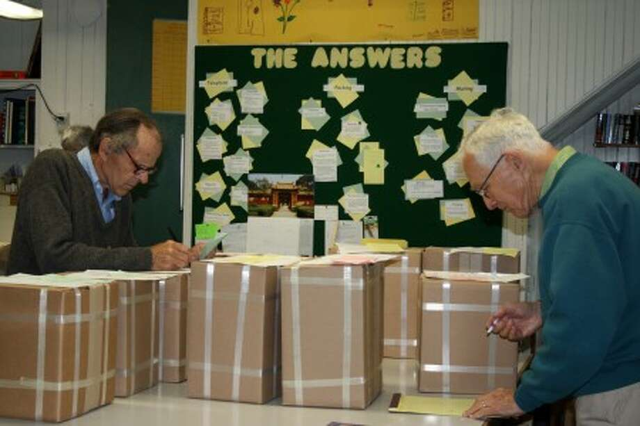 Volunteers prepare boxes of books for shipping at Darien Book Aid Plain. (Contributed photo/Geraldine Trippitelli)