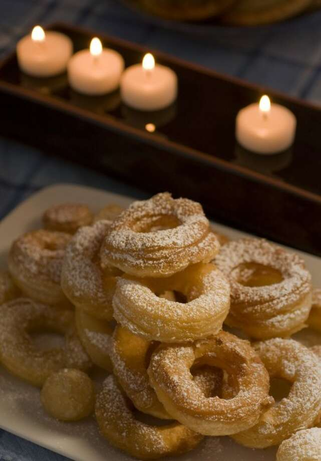 Puffed Doughnuts and Doughnut Holes are quite easy to make thanks to using frozen puff pastry dough. (AP Photo/Larry Crowe)