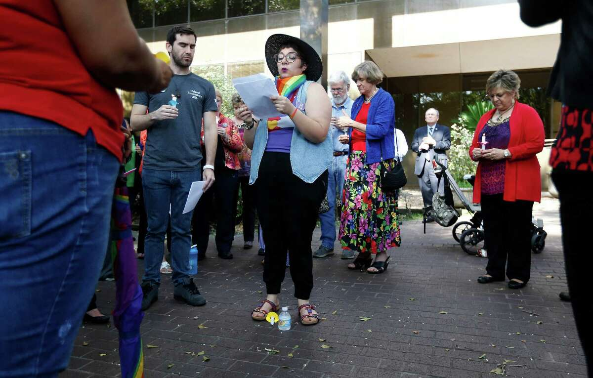 University of Houston Clear Lake student, Genesis Granados, reads aloud the names of the 49 victims of the Orlando nightclub shootings during a candlelight vigil for the victims, at the UHCL campus, Thursday, June 16, 2016, in Clear Lake. The Office of Intercultural Student Services put on the event, as part of the Women's and LGBT Services.