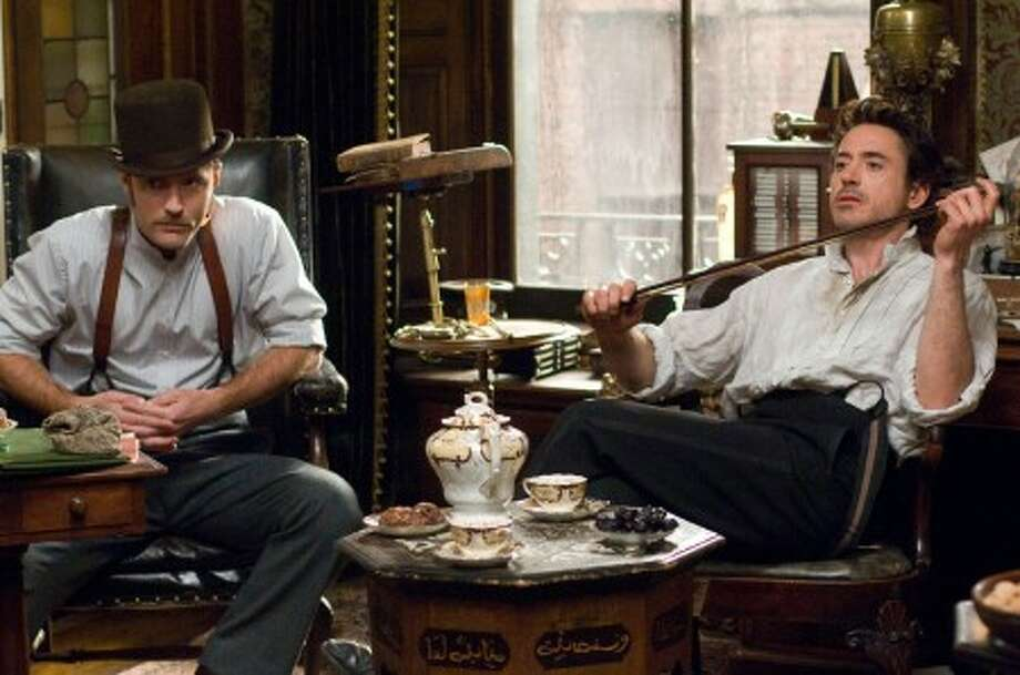 "JUDE LAW as Dr. Watson and ROBERT DOWNEY JR. as Sherlock Holmes in Warner Bros. Pictures'' and Village Roadshow Pictures'' action/adventure mystery ""SHERLOCK HOLMES."" ENW DIGITAL PHOTO."