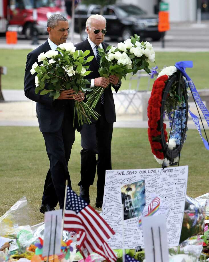 President Barack Obama and Vice President Joe Biden visit the makeshift memorial honoring the 49 people killed in the gay nightclub massacre. Photo: Joe Burbank, MBR / Orlando Sentinel