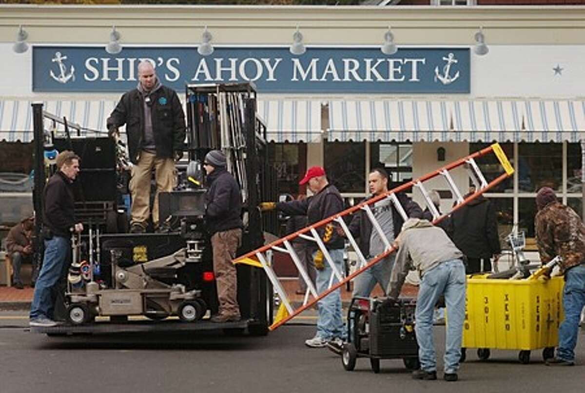 """Film crew shooting the motion picture """"We The Peeple''s"""" load equipment in front of Rowayton Market whose name was changed along with other local business to allow the town to double as Sag Harbor on Long Island. Hour photo / Erik Trautmann"""