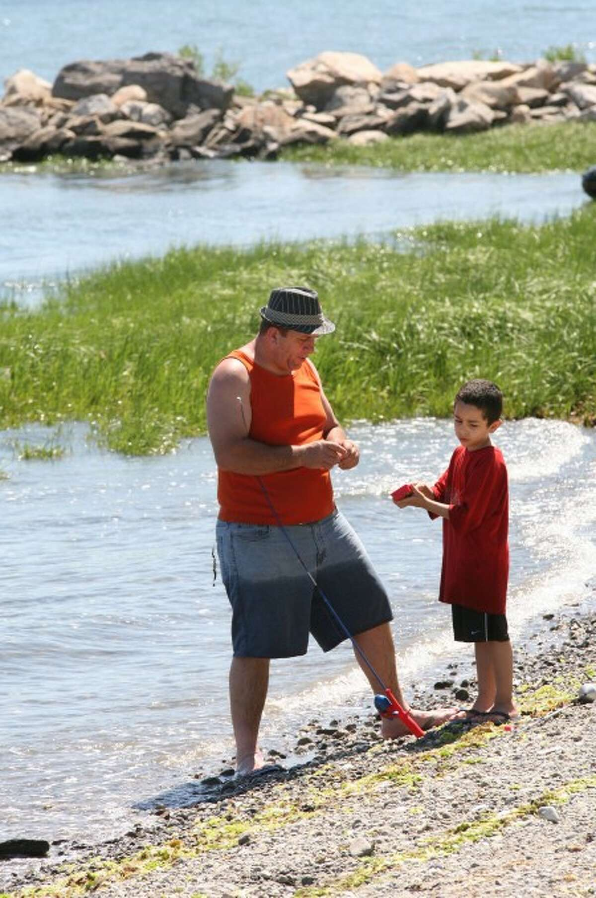 Great weather this Memorial Day weekend brought a father and son to Calf Pasture Beach in Norwalk for fishing Sunday afternoon. Hour Photo / Danielle Robinson