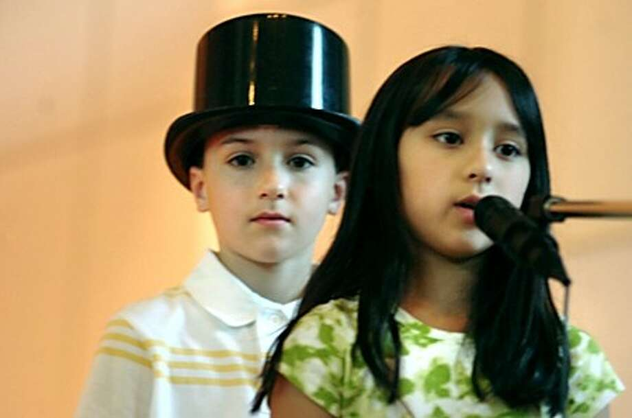 Fox Run students Gabriela Gaytan as an immigrant child and Shane Justice as Legrand Lockwood who built Norwalk''s lockwood Mathews Mansion rehearse the performance of It''s Your Life at the Norwalk City hall concert hall on Wednesday. The show be Thursday night/hour photo matthew vinci