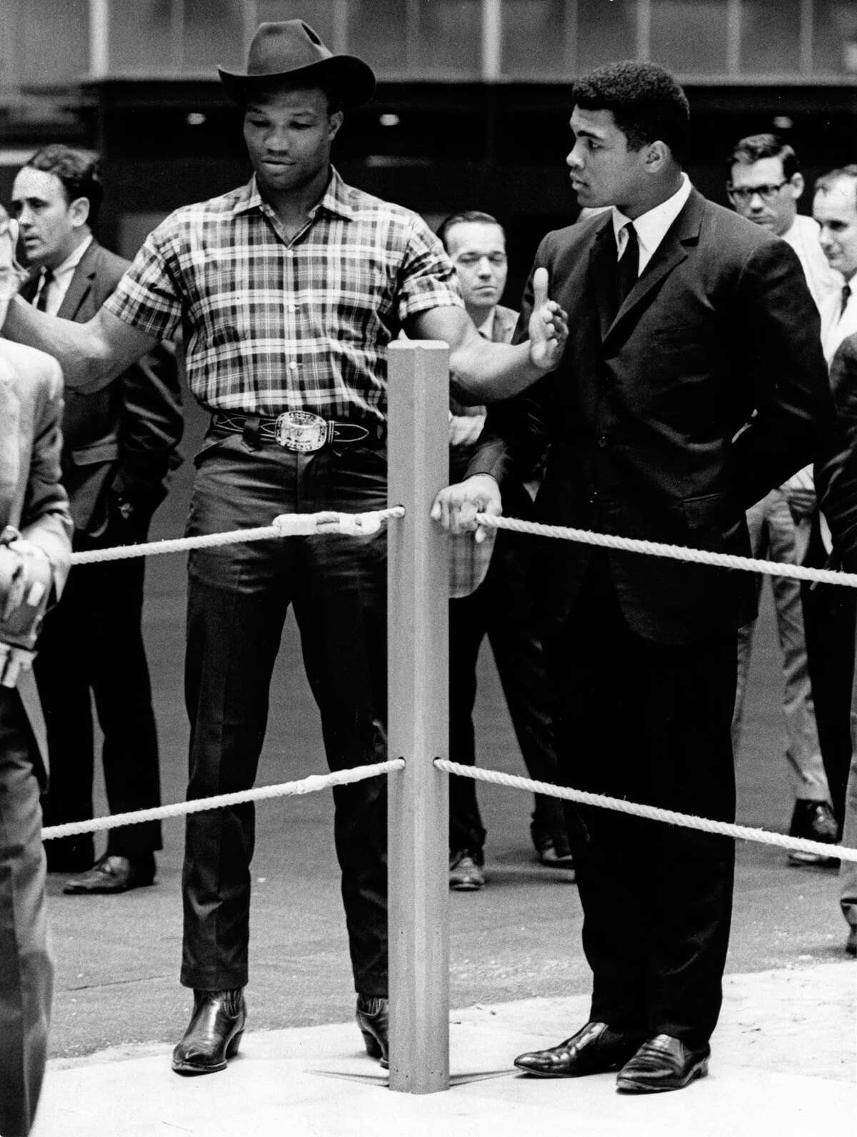 09/15/1966 - boxers Cassius Clay (aka Muhammad Ali) and Cleveland Williams at the Astrodome for official contract signing for title fight. The heavyweight title bout is scheduled to take place at the dome November 14, 1966.