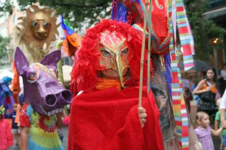 A person in costume walks down Washington Sreet in Norwalk Sunday afternoon during the SoNo Arts Festival''s annual Puppet Parade. Hour Photo / Danielle Robinson