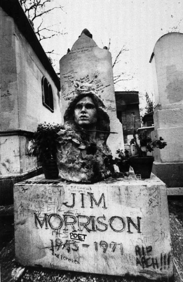 """FILE- This Sept. 7, 1971 file photo shows the grave of Jim Morrison, lead singer of the rock group """"The Doors,"""" at the Pere Lachaise cemetery in Paris, France. (AP Photo/Joe Marquette,File)"""