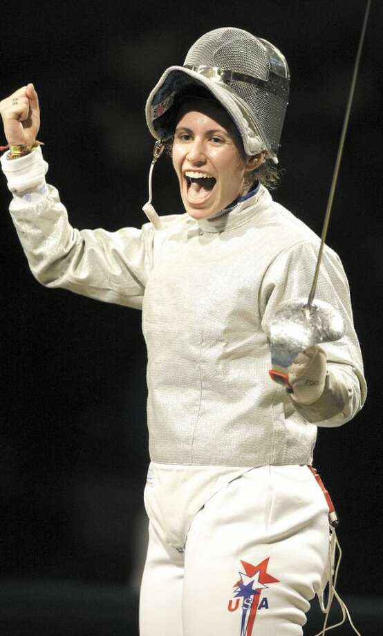 AP Photo - Success by USA''s Sada Jacobson, a Yale graduate who won the silver medal in fencing at the Olympics, brings more people into sports.