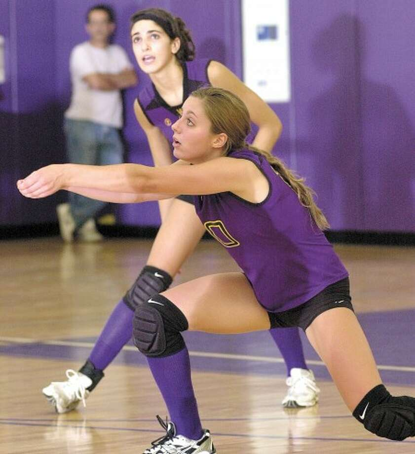 Photo by John Nash - Anna Grimaldi of Westhill focuses as she prepares to bump a ball to a teammate.