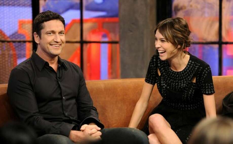 "Actor Gerard Butler, left, and host Alexa Chung appear on the set of MTV''s ""It''s On with Alexa Chung,"" at the MTV Times Square Studios on Monday, Oct. 19, 2009, in New York. (Photo by Evan Agostini/PictureGroup for MTV)"