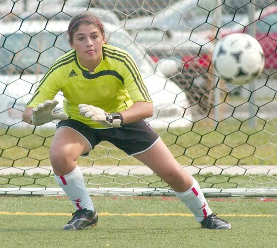 Photo by John Nash - Wilton girls soccer freshman goalie Kasey O''Brien.