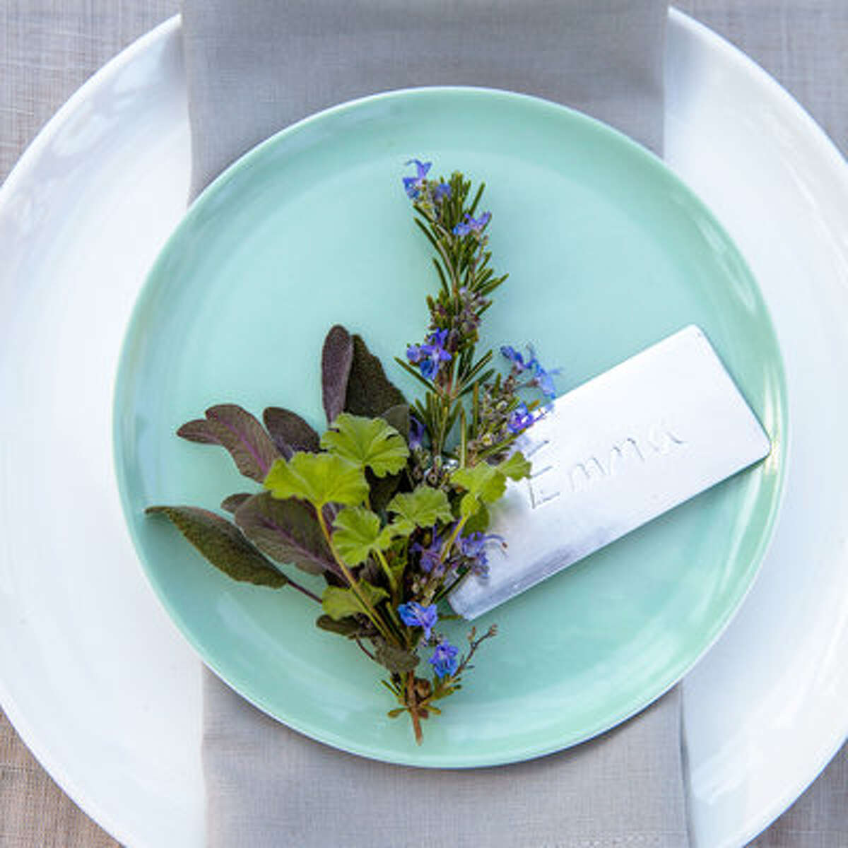 Freshen up Etch each guest's name on a metal plant tag with a pen tip, then wind the tag's wire around a cluster of rosemary, purple sage, and scented geranium leaves. cb2.com for Belay celery green salad plates.