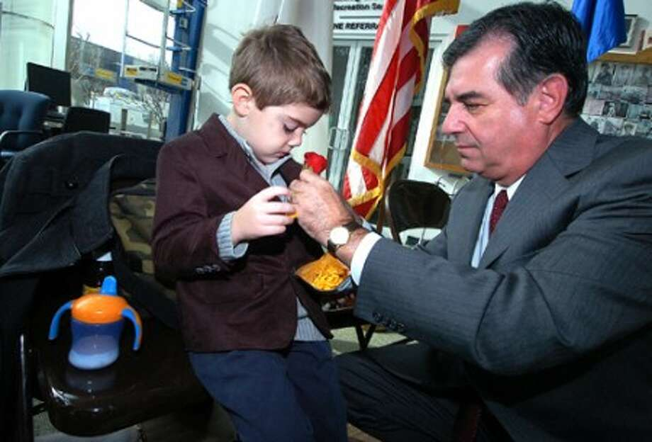 Photo/Alex von Kleydorff. Mayor Michael Pavia straightens the rose on 5 yr old Grandson Michael Garrison''s lapel after being sworn in at the Government center Tuesday morning.